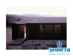 Деревянный дом на деревянных настилах