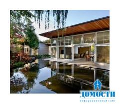Проект загородного дома с прудом