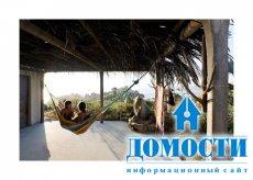 Дом с бассейном на крыше и панорамными видами на океан