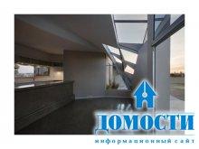 Скрученный бетонный дом