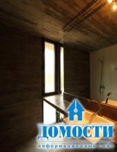 Г-образный дом из бетона