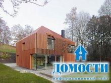 Дом, завернутый в деревянные рейки