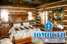 Спальня с бревенчатыми стенами